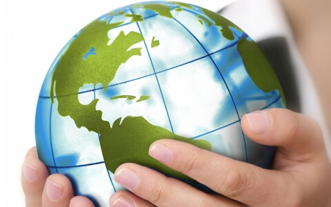 Holding a Globe Stock Photo